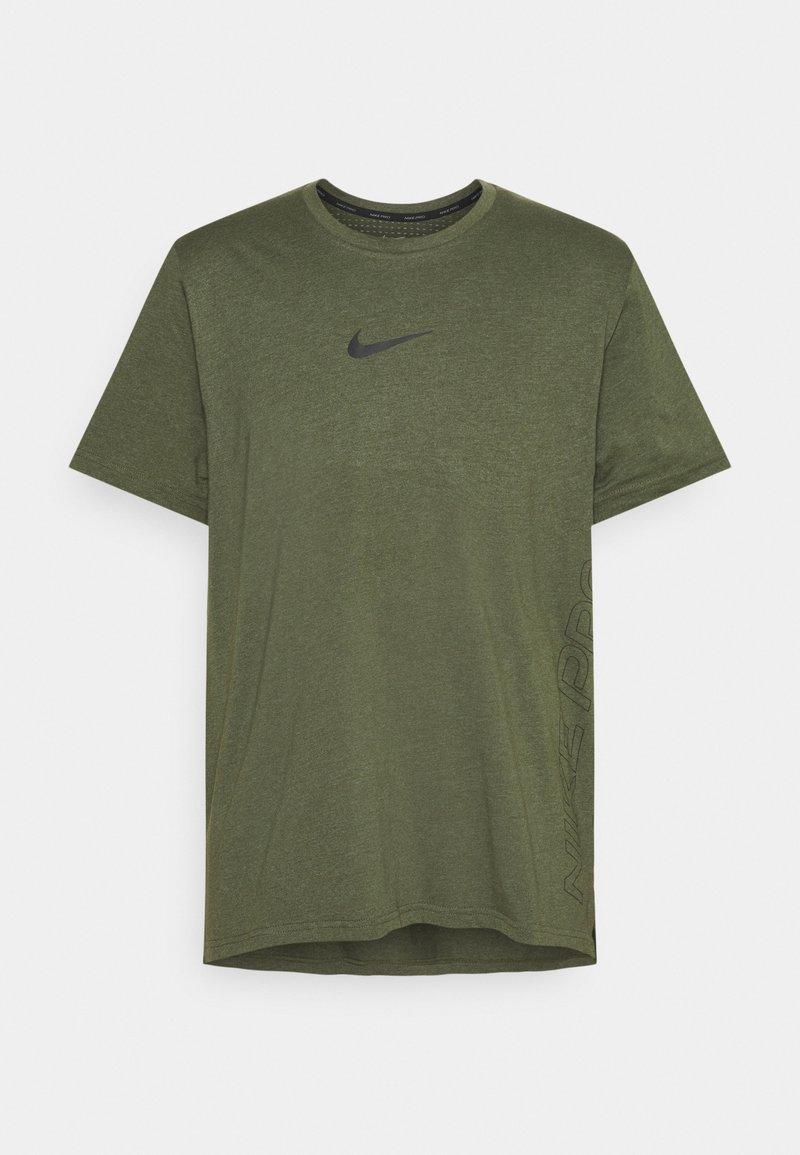 Nike Performance - BURNOUT - Print T-shirt - rough green/jade smoke/black