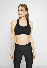 Cotton On Body - WORKOUT CUT OUT CROP - Light support sports bra - black - 0