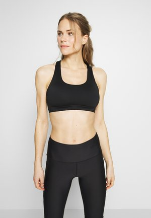 WORKOUT CUT OUT CROP - Light support sports bra - black