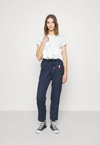 Tommy Jeans - PINSTRIPE PANT - Trousers - twilight navy/white - 1