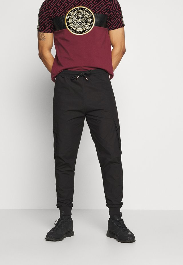 ALPHA UTILITY TROUSERS - Cargo trousers - black