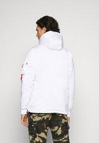 Alpha Industries - ANORAK - Light jacket - white - 2