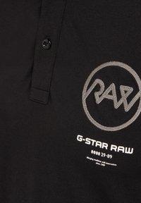 G-Star - GS RAW GRAPHIC SLIM - Polo shirt -  black - 2