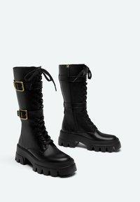 Uterqüe - Šněrovací vysoké boty - black - 1