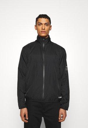 DATHLETIC - Training jacket - black