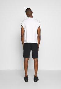 Napapijri - NERT - Teplákové kalhoty - black - 2
