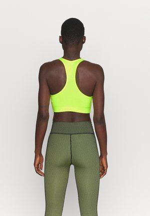 PRESELLE - Medium support sports bra - neon yellow