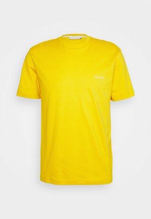 CHEST LOGO - Basic T-shirt - yellow