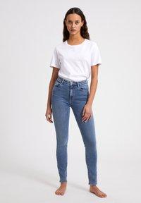 ARMEDANGELS - TILLAA CIRCULAR - Jeans Skinny Fit - light blue - 1