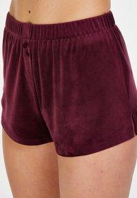 Hunkemöller - Pyjama bottoms - red - 2