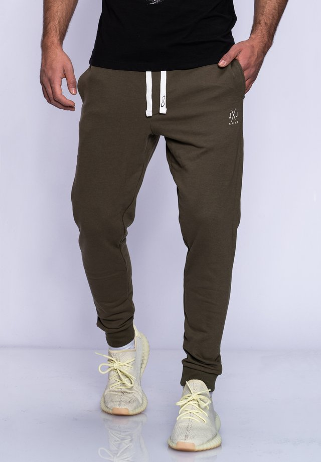 HAVOS - Tracksuit bottoms - olive night