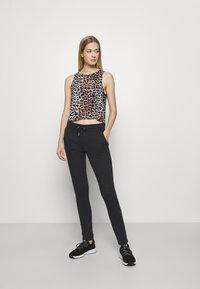 Fila - KARLA - Teplákové kalhoty - black - 1