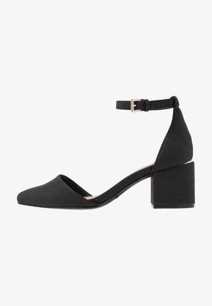 DRIZZY - Classic heels - black