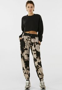 Bershka - Tracksuit bottoms - black - 1
