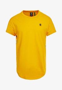 SWANDO ART RELAXED - T-shirt print - gold