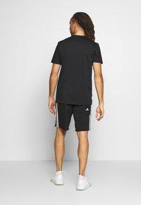 adidas Performance - MIX TEE - Print T-shirt - black/white - 2