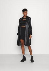 Even&Odd - Basic mini ribbed skirt - Kynähame - black - 1