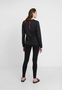 EA7 Emporio Armani - TRAIN LOGO SERIES - Sweatshirt - black / neon pink - 2