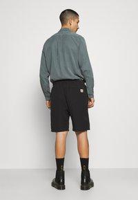 Carhartt WIP - CLOVER LANE - Shorts - black - 2