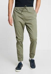 Solid - TRUC CUFF - Trousers - dusty oliv - 0