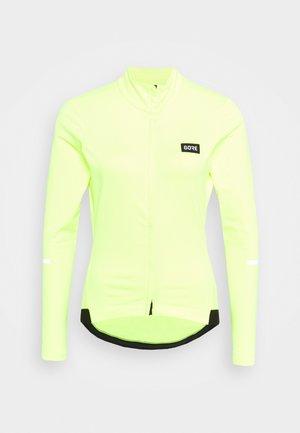 GORE® WEAR PROGRESS THERMO WOMENS - Training jacket - neon yellow