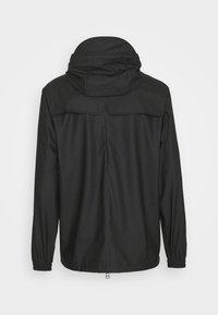 Rains - STORM BREAKER UNISEX - Vodotěsná bunda - black - 7