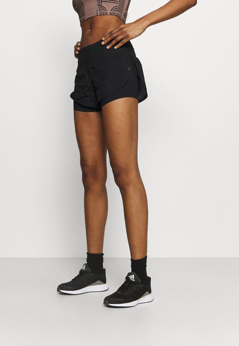 Under Armour - RUSH STAMINA SHORT - Sports shorts - black