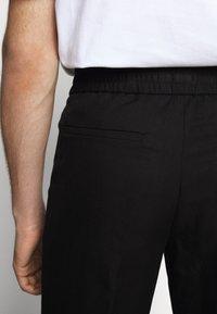 Filippa K - TERRY CROPPED SLACKS - Trousers - black - 6