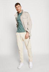 Tommy Hilfiger - Poloshirts - green - 1