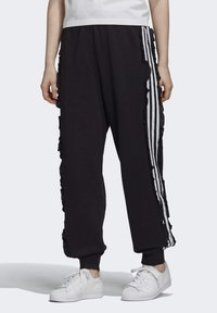 adidas Originals - BELLISTA SPORTS INSPIRED JOGGER PANTS - Pantalones deportivos - black - 0