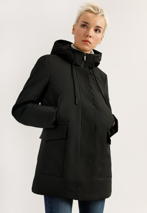 MIT AUFGESETZTEN TASCHEN - Winter coat - black