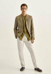 Massimo Dutti - IM VINTAGELOOK  - Trousers - beige - 1