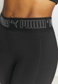 Puma - TRAIN ELASTIC 7/8 - Leggings - black - 4