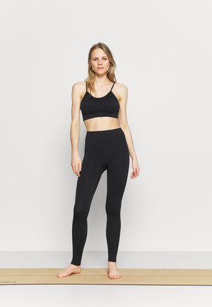 ELIANA - Light support sports bra - black