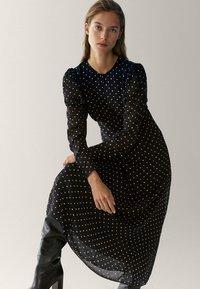 Massimo Dutti - MIT TUPFEN  - Maxi dress - black - 1