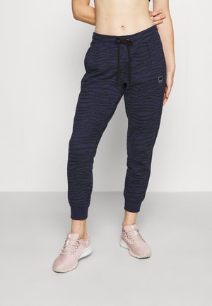 TIGER KING RELAXED SIDE PANEL - Tracksuit bottoms - midnight