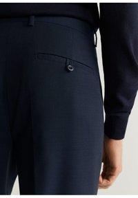 Mango - TRAVEL - Suit trousers - dunkles marineblau - 4