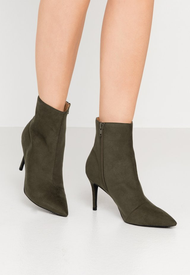 High heeled ankle boots - dark green