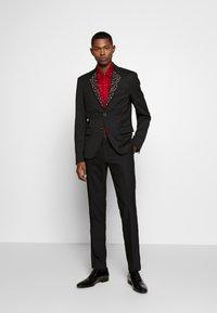 Just Cavalli - EMBELLISHED JACKET - Suit jacket - black - 1