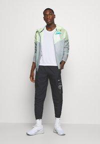 Nike Performance - PANT - Tracksuit bottoms - black/silver - 1