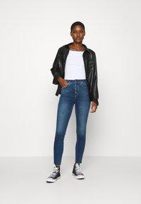 Calvin Klein Jeans - LOGO TRIM BARDOT - Print T-shirt - bright white - 1