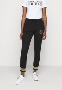 Versace Jeans Couture - Tracksuit bottoms - black/gold - 0