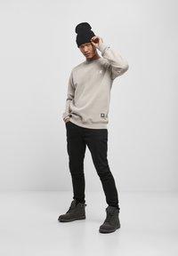 Starter - Sweatshirt - grey - 1