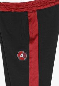 Jordan - REMASTERED PANT - Pantalones deportivos - black - 3