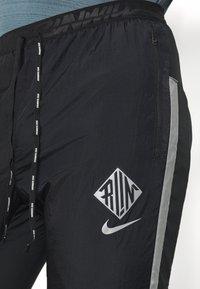 Nike Performance - ELITE PANT - Teplákové kalhoty - black/reflective silver - 4