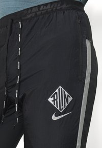 Nike Performance - ELITE PANT - Tracksuit bottoms - black/reflective silver - 4