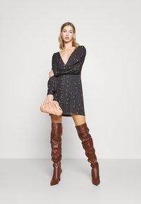 Milk it - MYSTICAL DRESS RUCHED BUST & HOOK ANDEYE DETAILING - Day dress - black - 1