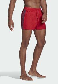 adidas Performance - CLASSIC 3-STRIPES SWIM SHORTS - Swimming shorts - red - 0