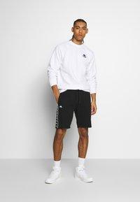 Kappa - GAWINJO - Pantalón corto de deporte - caviar - 1