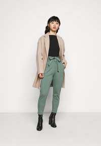 Vero Moda Petite - VMEVA LOOSE PAPERBAG PANT - Trousers - laurel wreath - 1